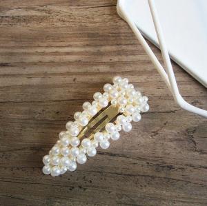 Hårspänne med pärlor guld
